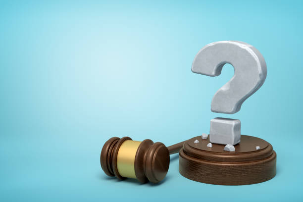 3d rendering of hefty stone question mark standing on sounding block with gavel beside on light-blue background with copy space. - язык знаковая система стоковые фото и изображения
