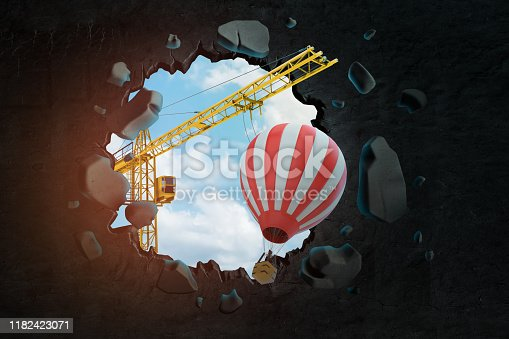 3d rendering of hoisting crane carrying striped hot-air balloon and breaking hole in black wall with blue sky seen through. Creative thinking. Using imagination. Graphic design.