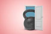 istock 3d rendering of huge black 24 kg kettlebell emerging from white door on pink gradient copy space background. 1182422944