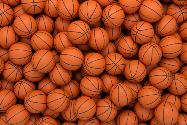 3d rendering of many orange basketball balls lying in an endless pile seen from the top. - basket foto e immagini stock