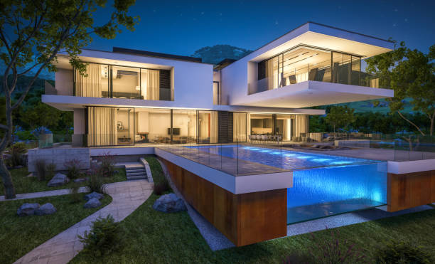 3d rendering of modern cozy house by the river at night stock photo