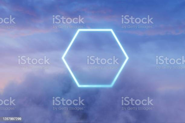Photo of 3d rendering of neon hexagon shape above fluffy clouds in front of moody sky