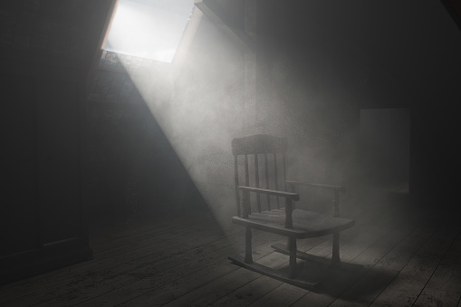 istock 3d rendering of old rocking chair at dark attic with light ray. Concept age and past 1176089408