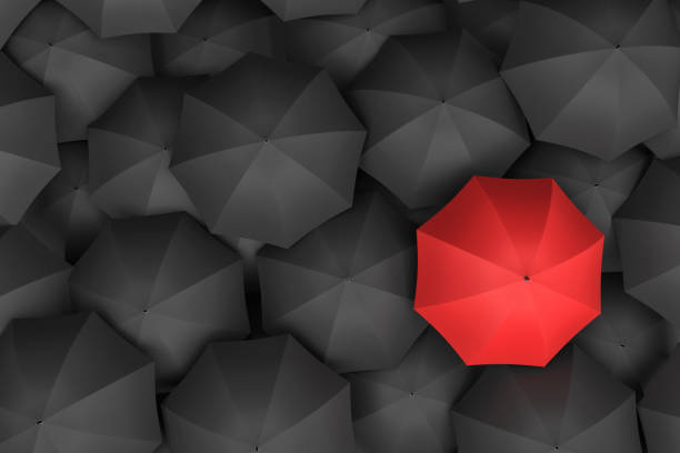 3d rendering of open bright red umbrella towering over an endless amount of similar black umbrellas stock photo