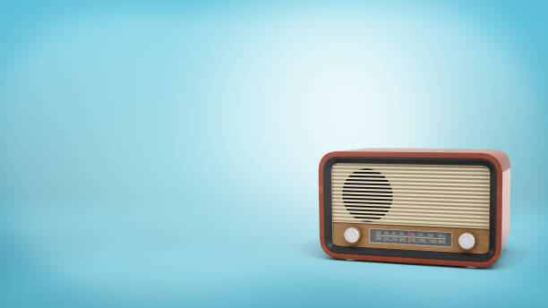 3d rendering of retro-style radio set in brown color with a speaker and tuner knobs stands on blue background 3d rendering of retro-style radio set in brown color with a speaker and tuner knobs stands on blue background. News update. Vintage appliances. Old school technology. sea channel stock pictures, royalty-free photos & images