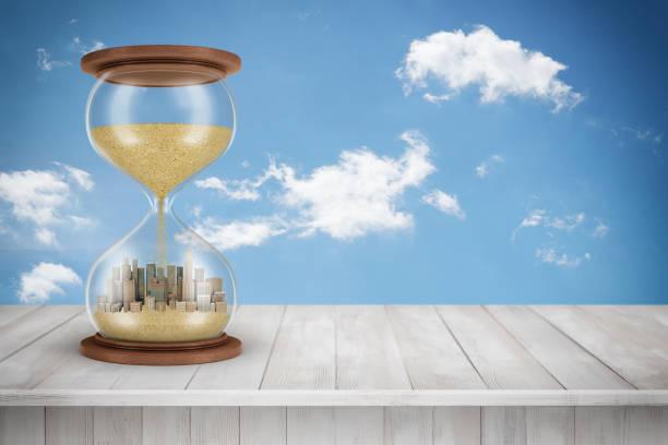 3d-rendering van zand glas met wolkenkrabbers binnen op wit houten oppervlak en witte wolken achtergrond - zandloper icoon stockfoto's en -beelden