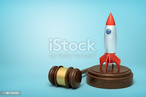 istock 3d rendering of silver red space rocket on round wooden block and brown wooden gavel on blue background 1180194351