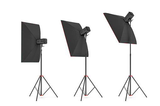 3d rendering of studio flash with big size softboxes stands turned down in several angles