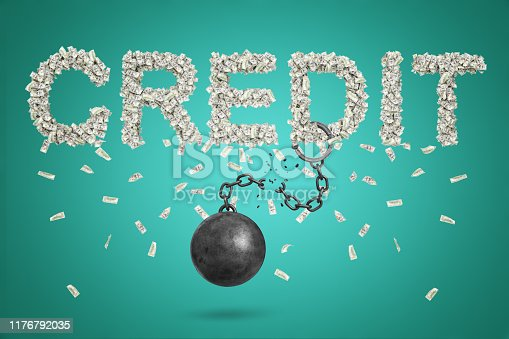 3d rendering of the title 'CREDIT' formed with dollar bills, with a broken shackle ball chain dangling off letter D. Banking and finance. Grow out of debt burden. Financial independence.
