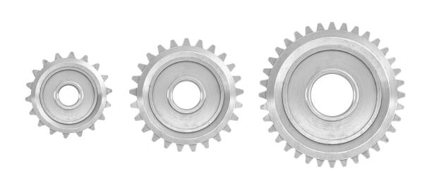 3d rendering of three straight gears of different sizes in front view isolated on a white background - ingranaggio foto e immagini stock