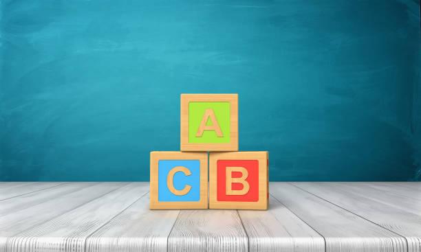 rendu 3D de trois blocs de jouets de différentes couleurs avec des lettres A, B et C sur eux debout sur un bureau en bois. - Photo