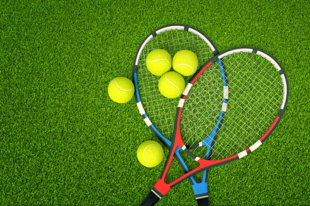 3d rendering of two tennis rackets and yellow tennis balls on green grass background - racket stock pictures, royalty-free photos & images