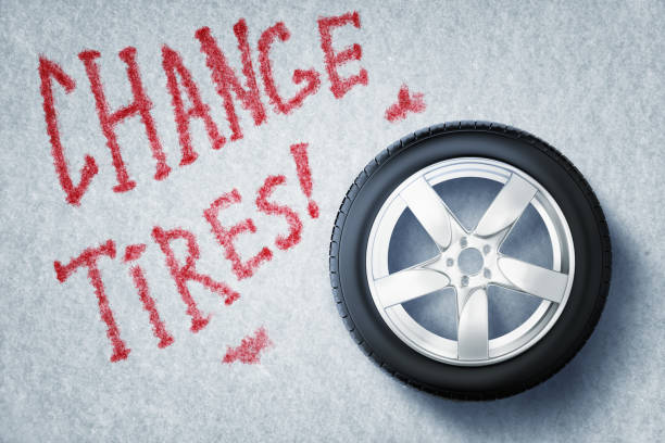 """3d rendering of vehicle tire with red sign """"CHANGE TIRES!"""" on grey background"""