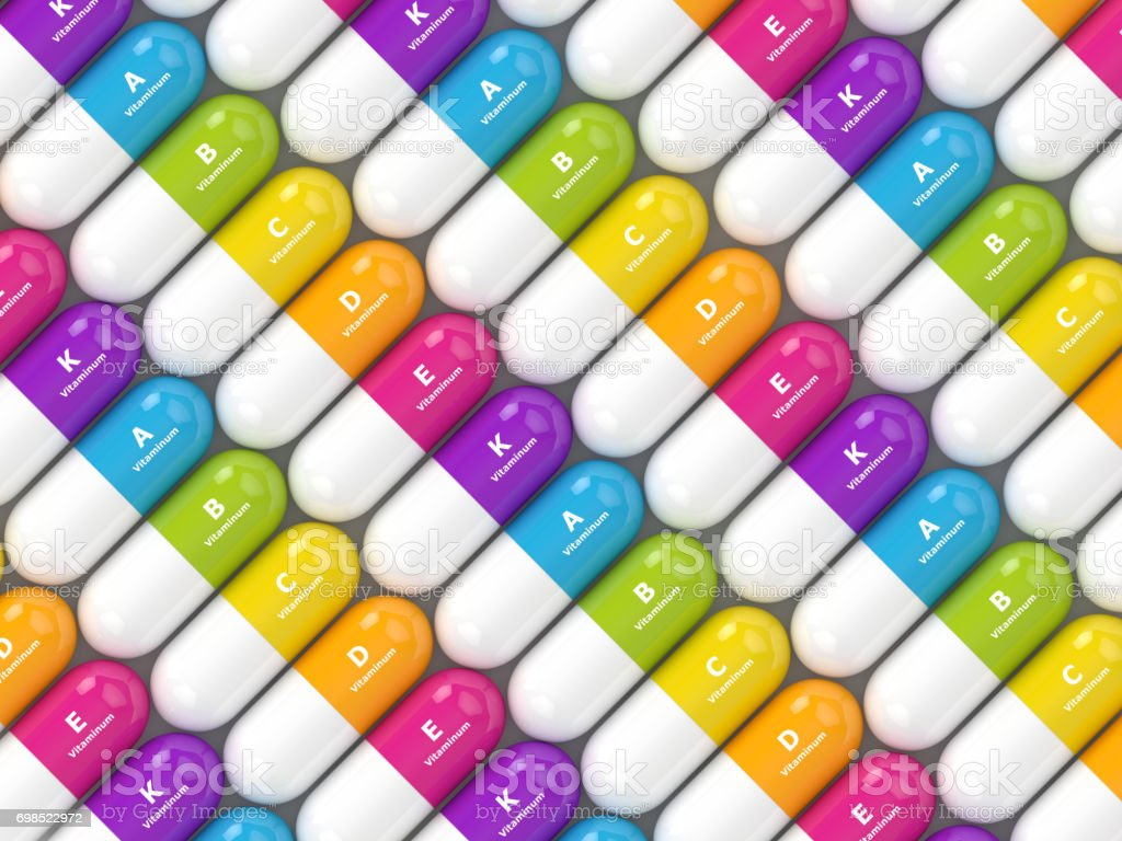 3d rendering of vitamin pills in row stock photo