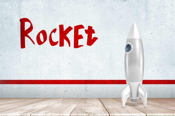 """3d rendering of white silver rocket on white wooden floor with red """"rocket"""" sign above - rocket logo stock photos and pictures"""