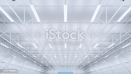 3d rendering of empty warehouse building with roof sheet and truss structure.