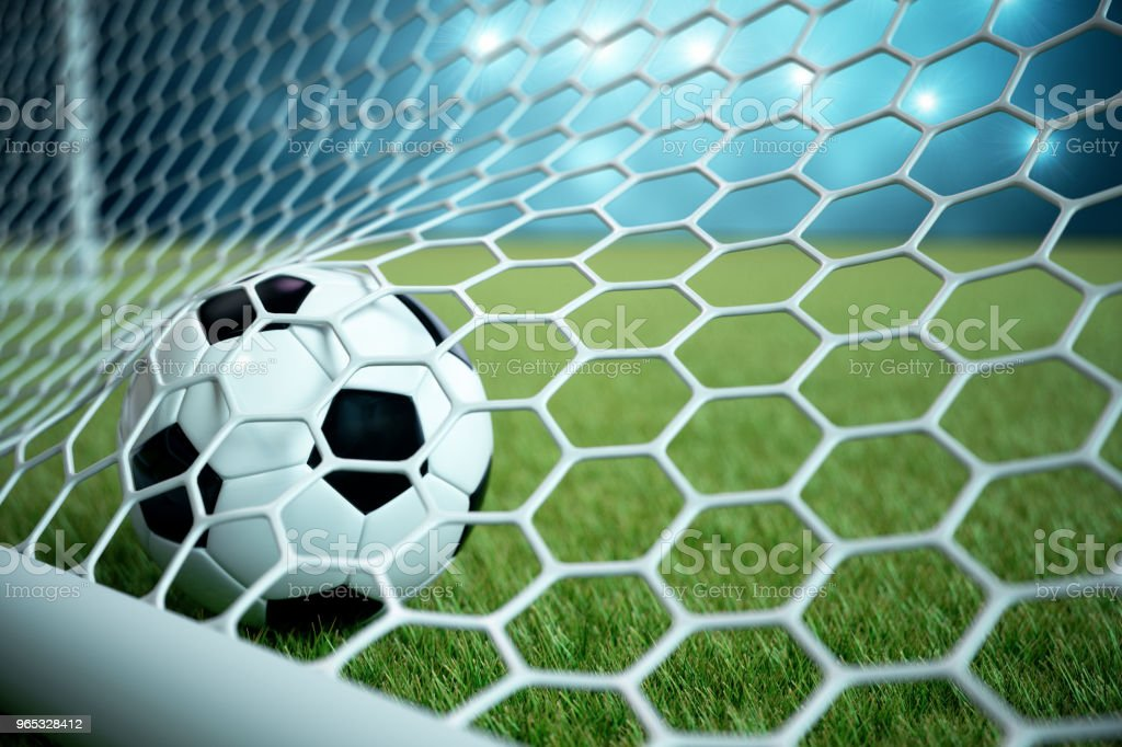3d rendering soccer ball in goal. Soccer ball in net with spotlight and stadium light background, Success concept. Soccer ball on blue background with grass. zbiór zdjęć royalty-free