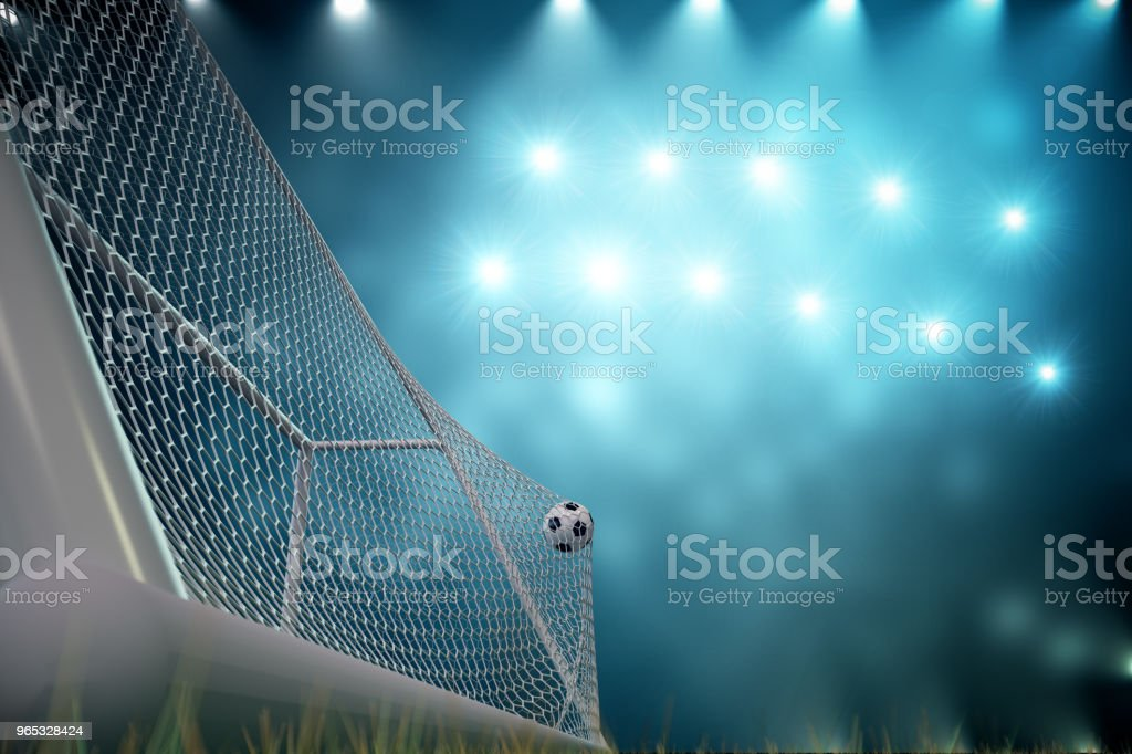 3d rendering soccer ball in goal. Soccer ball in net with spotlight and stadium light background, Success concept. Soccer ball on blue background with grass. royalty-free stock photo