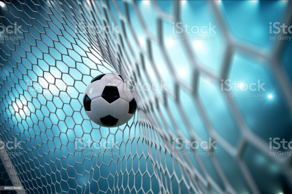 3d rendering soccer ball in goal. Soccer ball in net with spotlight and stadium light background, Success concept. Soccer ball on blue background. zbiór zdjęć royalty-free