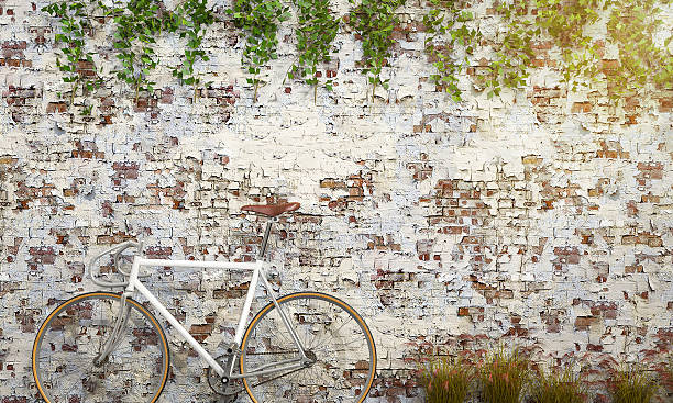 3d rendering white bicycle near antique brick wall stock photo