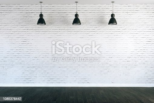 istock 3d room with white brick wall and ceiling lamp 1085376442