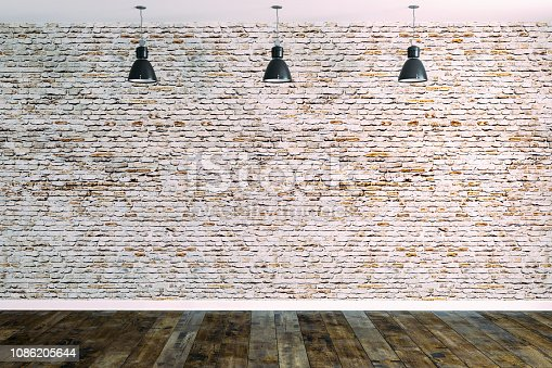 istock 3d room with white brick wall and ceiling lamp 1086205644