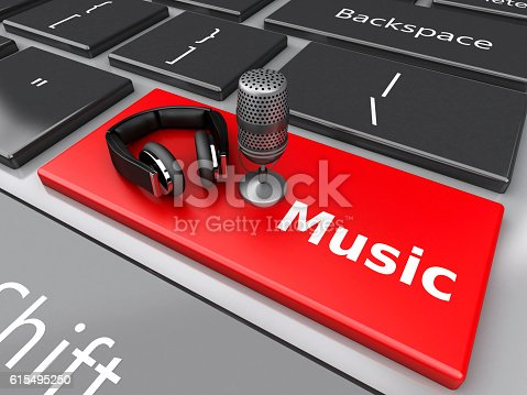 istock 3d Word music with headphones and mic on computer keyboard. 615495250