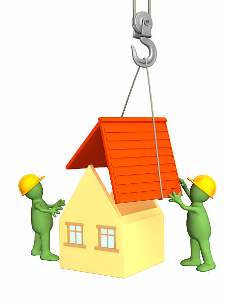 3d working puppets building the house stock photo