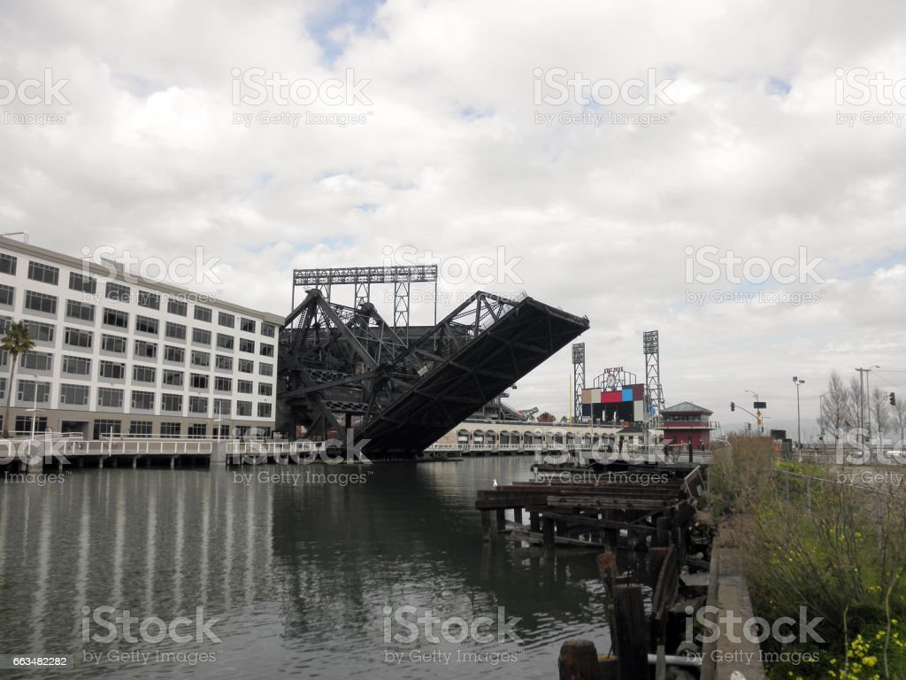 3rd street bridge rises into the air with AT&T Park in the Background stock photo
