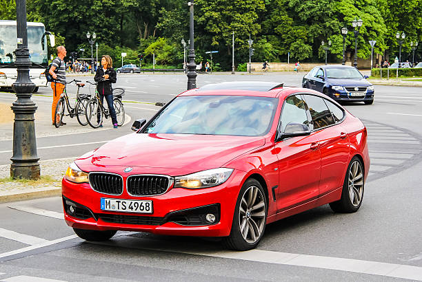 BMW F34 3-series GT Berlin, Germany - August 15, 2014: Modern red car BMW F34 3-series GT drives at the city street. touring car stock pictures, royalty-free photos & images