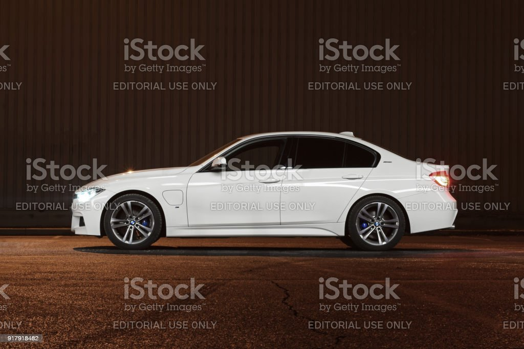 BMW 3-series in plug-in hybrid version at night stock photo