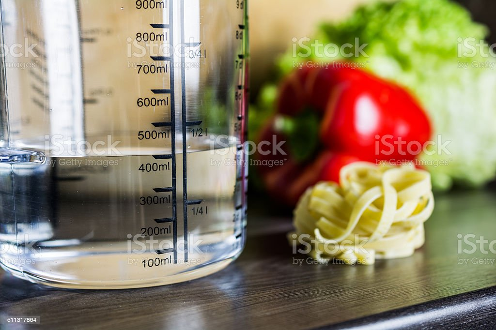 kitchen counter with food. 400ml Water In Measuring Cup On Kitchen Counter With Food Royalty-free Stock Photo T