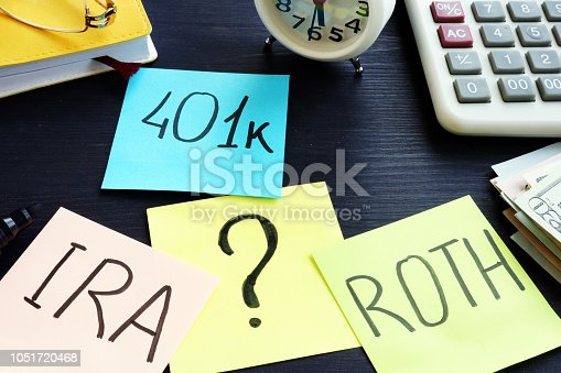401k ira roth on pieces of paper. Retirement planning.
