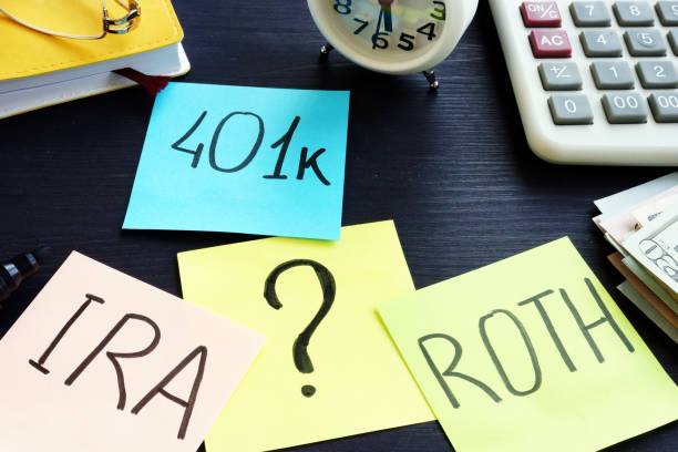401k ira roth on pieces of paper. Retirement planning. 401k ira roth on pieces of paper. Retirement planning. 401k stock pictures, royalty-free photos & images