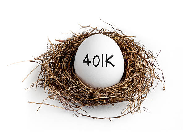 401k - Nest Egg A white egg in a nest on a white background with the word 401K on the egg. 401k stock pictures, royalty-free photos & images