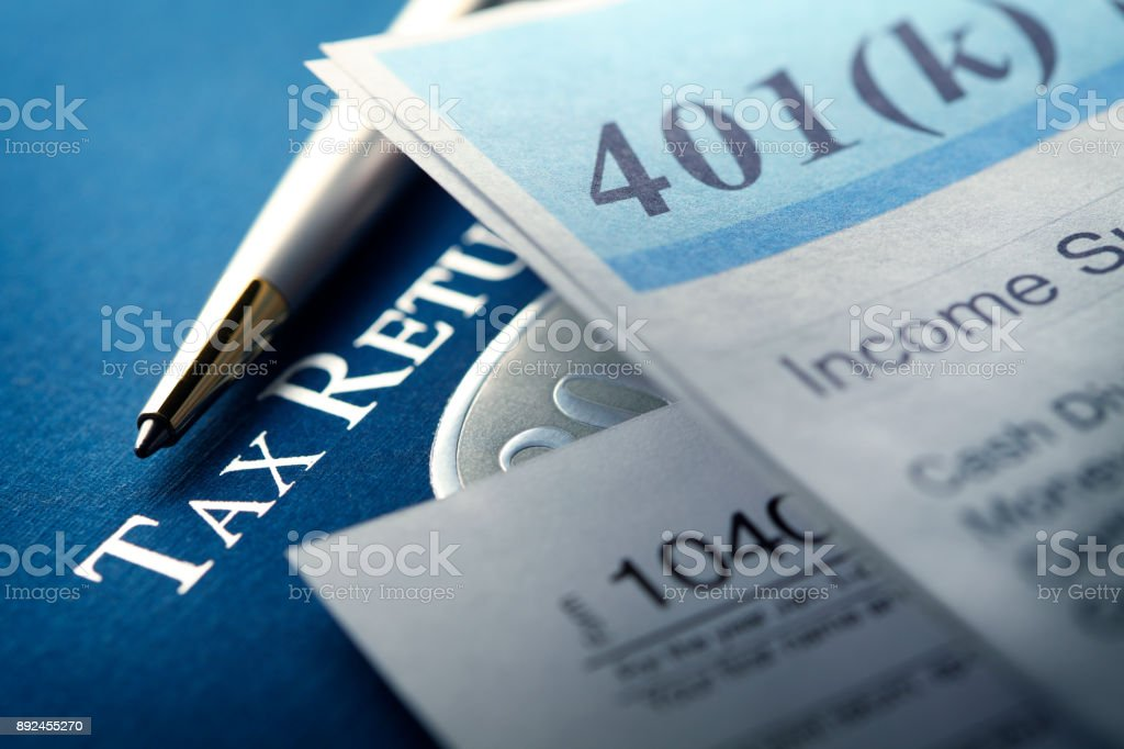 401k Statement And Federal Tax Return stock photo