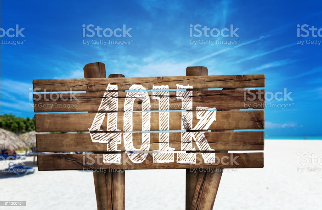 401k wooden sign on the beach stock photo