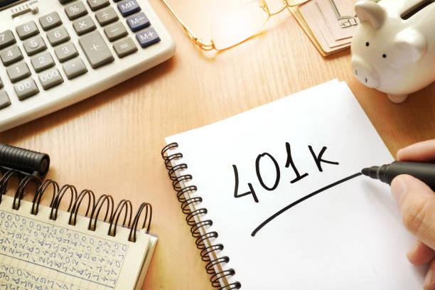 401k written in a note. pension concept. - буква k стоковые фото и изображения