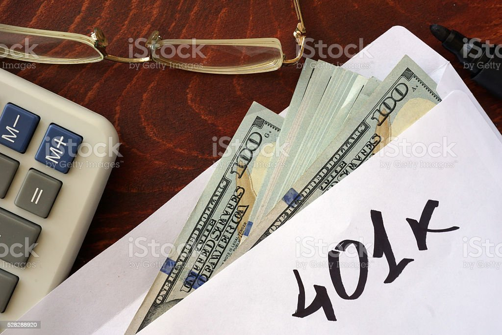 401k written on an envelope with dollars. Savings concept. stock photo