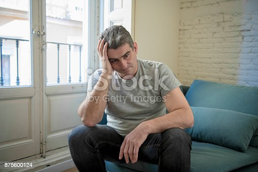 istock 40s or 50s sad and worried man with grey hair sitting at home couch looking depressed and wasted in sadness face expression in depression and life problems concept 875600124