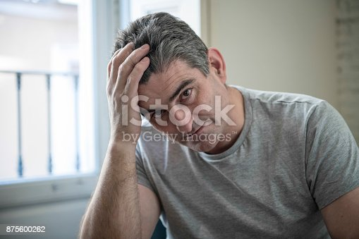 istock 40s or 50s sad and worried man with grey hair sitting at home couch looking depressed and wasted in sadness face expression in depression and life problems concept 875600262