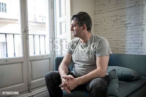 istock 40s or 50s sad and worried man with grey hair sitting at home couch looking depressed and wasted in sadness face expression in depression and life problems concept 875602488