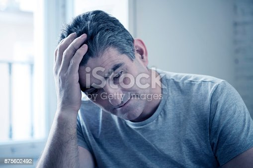 istock 40s or 50s sad and worried man with grey hair sitting at home couch looking depressed and wasted in sadness face expression in depression and life problems concept 875602492