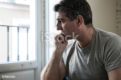 istock 40s or 50s sad and worried man with grey hair sitting at home couch looking depressed and wasted in sadness face expression in depression and life problems concept 875602500