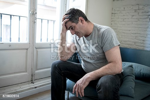 istock 40s or 50s sad and worried man with grey hair sitting at home couch looking depressed and wasted in sadness face expression in depression and life problems concept 875602514