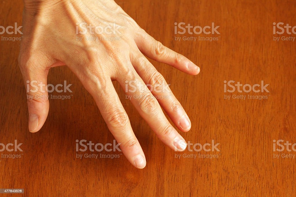 40s, the left hand of 50-something women stock photo