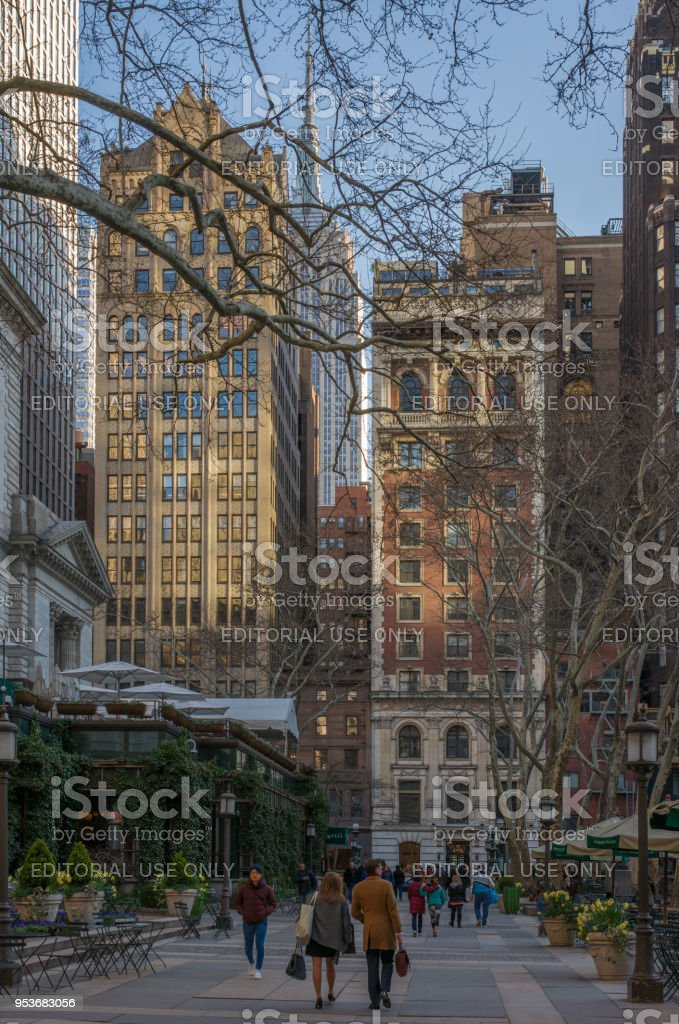 40th Street in Sunset with People Strolling in Bryant Park stock photo