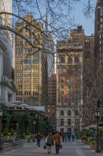40th Street in Sunset with People Strolling in Bryant Park