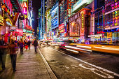 Night life on busy 42nd street near 8th avenue in Middtown Manhattan, New York City.