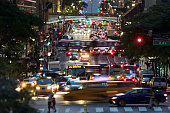 42nd Street is crowded with the busy night lights of crosstown traffic through Midtown Manhattan in New York City NYC